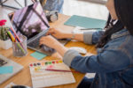 Girl at desk with Laptop_Feng Shui Focus Tips