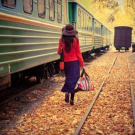 CNY Travel Dates_Lady walking next to train