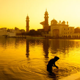 Indian City with river in yellow light_Fengshui tips for travel luck