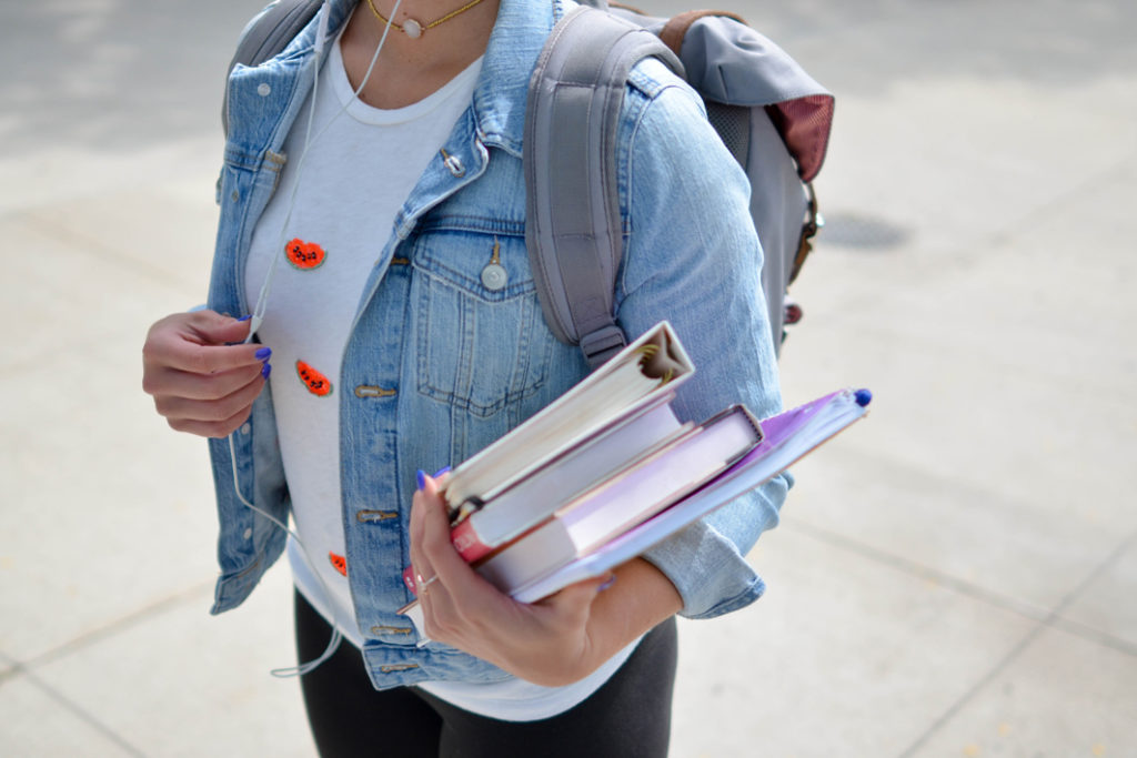 Girl with books and school bag_Feng Shui Focus Tips