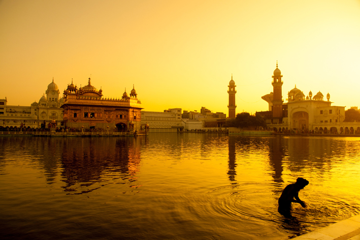 Indian City with river in yellow light_Feng Shui Travel Tips