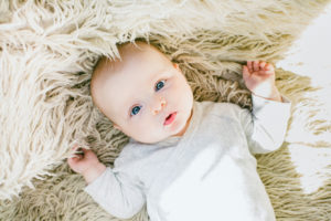 Baby on fluffy sheep's rug